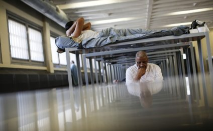A detainee lies in his bunk at