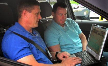 Officers Ned Bandoske (left)